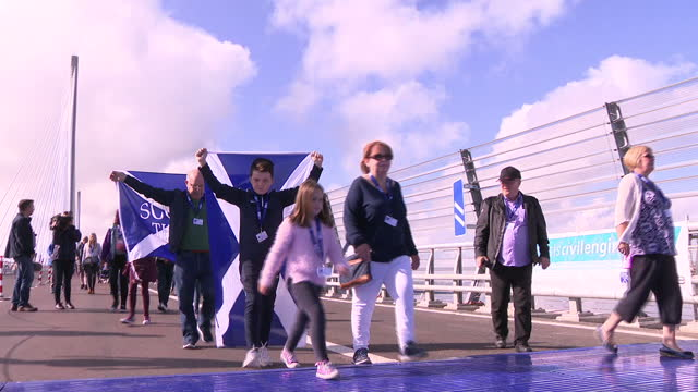 Shows exterior shots Nicola Sturgeon joining crowds of walkers on new Queensferry crossing bridge including some waving Scottish Saltire flags First...