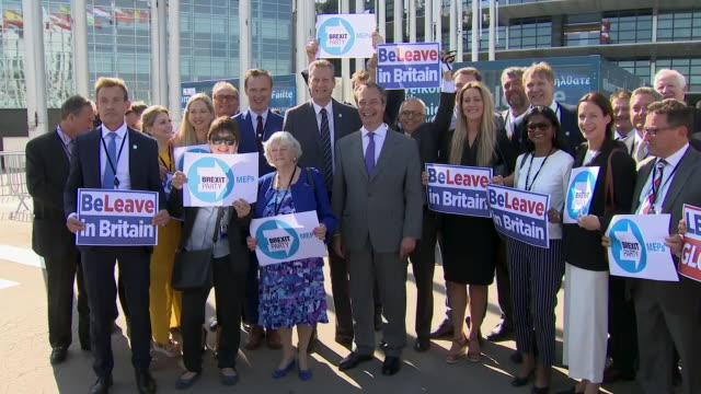 shows exterior shots nigel farage mep and other brexit party meps arriving at the european parliament and interview with him speaking about brexit,... - mep stock videos & royalty-free footage