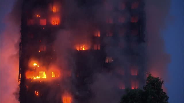 Shows exterior shots night shots fires burning across upper floors and clouds of smoke of Grenfell Tower Block in West London A huge fire tore...