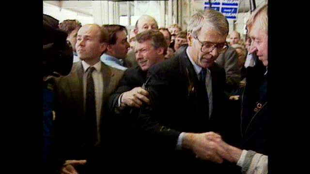 shows exterior shots of john major getting hit by an egg whilst out on the campaign trail in southampton exterior shots of man being arrested shots... - john major stock-videos und b-roll-filmmaterial
