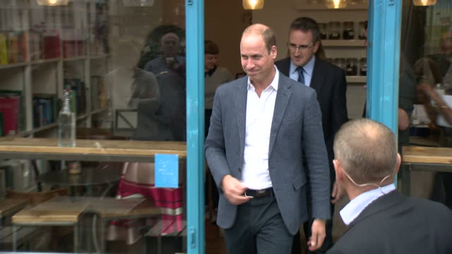 shows exterior shots paper cup a cafe run by the charity spitalfields crypt trust with security officer standing outside and prince william and... - 訪問点の映像素材/bロール