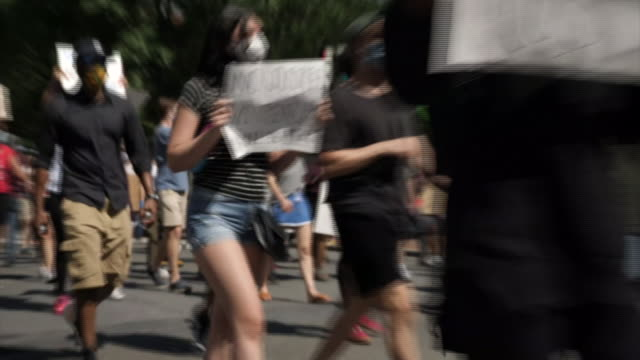 shows exterior shots peaceful protesters marching through washington dc past the white house holding signs and shouting slogans including black lives... - tranquility stock videos & royalty-free footage