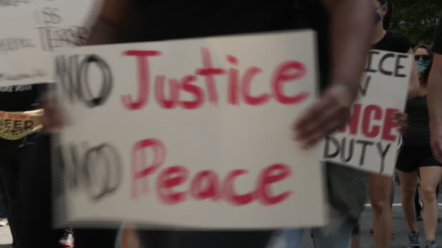 "shows exterior shots peaceful protesters marching through washington dc, past the white house, holding signs and shouting slogans including ""black... - tranquility stock videos & royalty-free footage"