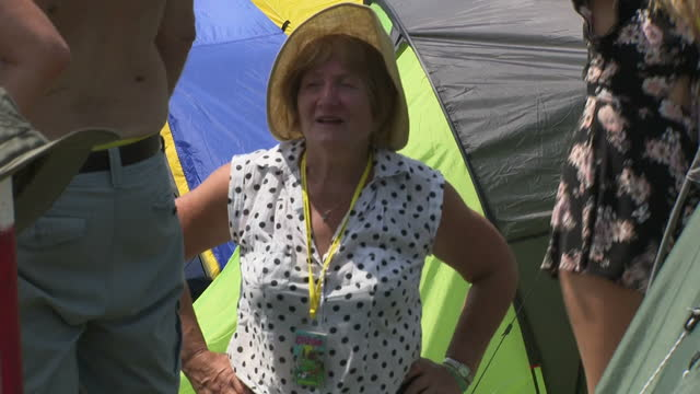 Shows exterior shots people resting and looking hot after setting up their tents at Glastonbury Festival campsite on 22nd June 2017 in Glastonbury...