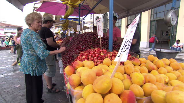 shows exterior shots people shopping at fruit market in athens on june 28 2015 in athens greece - panathinaiko stadium stock videos & royalty-free footage