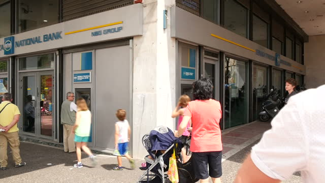 shows exterior shots people using cash machines at a branch of national bank on june 28 2015 in athens greece - panathinaiko stadium stock videos & royalty-free footage