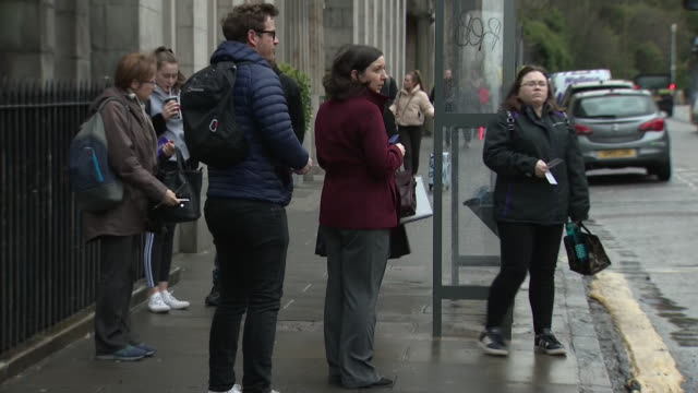 shows exterior shots people waiting at bus stops and boarding buses in edinburgh city centre, on 12th march 2020 in edinburgh, scotland, united... - waiting stock videos & royalty-free footage