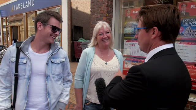 stockvideo's en b-roll-footage met shows exterior shots people walking about in chelmsford. voxpops on voting in eu referendum. exterior shots conservative 'in' campaigners talking to... - referendum over europese unie 2016