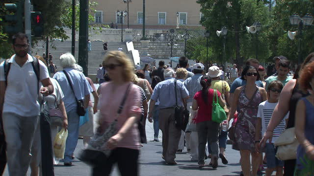 Shows exterior shots people walking through Syntagma Square on July 22 2015 in Athens Greece