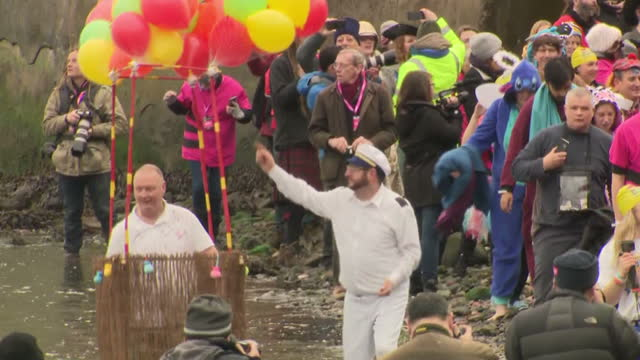 shows exterior shots people wearing all kinds of costumes arriving on the beach on the side of the forth and running in to the sea to complete the... - edinburgh scotland stock videos & royalty-free footage