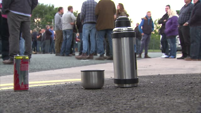 stockvideo's en b-roll-footage met shows exterior shots person pouring tea from a flask protesters talking among themselves at blockade on august 09 2015 in wigan united kingdom - dairy product