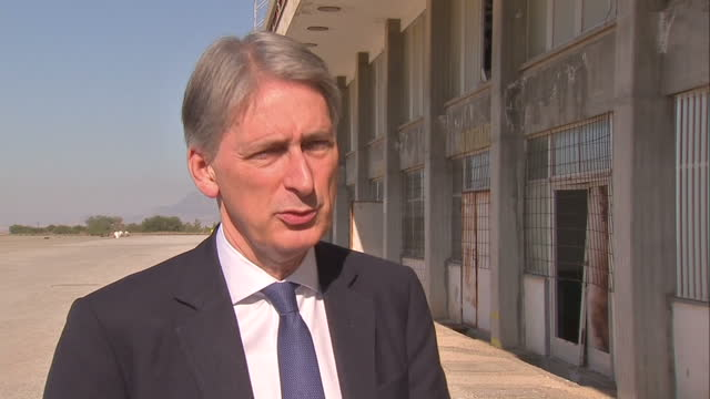 shows exterior shots philip hammond walking with officials and military personnel interview with uk foreign secretary philip hammond on fighting isis... - military attack stock videos and b-roll footage