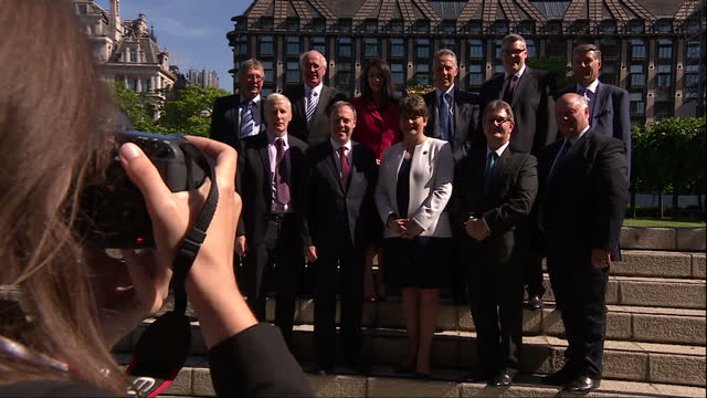 Shows exterior shots photocall for new DUP MPs and DUP Leader Arlene Foster on steps outside the Houses of Parliament Members of the DUP attend...