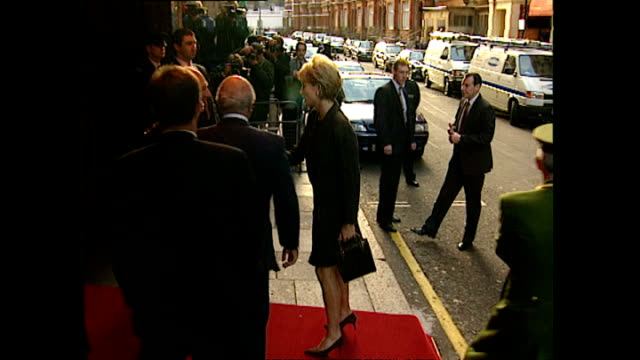shows exterior shots photographers taking photos and policeman waiting outside harrods. exterior shots princess diana arriving by car, shaking hands... - photographer stock videos & royalty-free footage