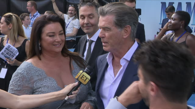 Shows exterior shots Pierce Brosnan talking to cast mates and press at the 'blue' carpet British Premiere of the film sequel Mamma Mia Here We Go...