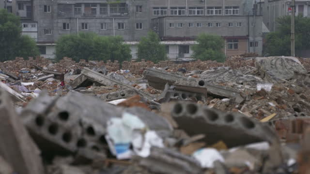 shows exterior shots piles of rubble and debris from demolished buildings and neighbourhoods on the outskirts of beijing authorites in beijing are... - lavoratore emigrante video stock e b–roll