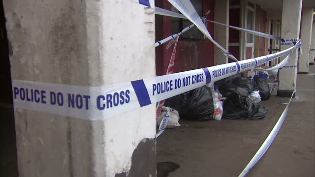 Shows exterior shots police do not cross cordon tape around murder crime scene on the Aylesbury Estate A teenager killed in a row over a mobile phone...