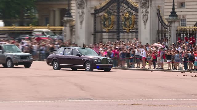 shows exterior shots police vehicles parked outside buckingham palace in london and queen elizabeth ii and prince charles in car arriving back at... - the queen's speech state opening of uk parliament stock videos & royalty-free footage