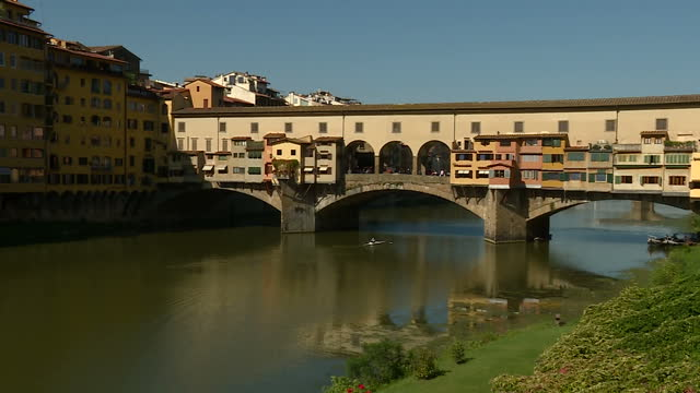 shows exterior shots ponte vecchio bridge over the river arno boats on river and traffic and pedestrians crossing bridge on 22nd september 2017 in... - ponte stock-videos und b-roll-filmmaterial