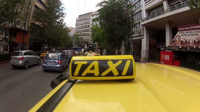 shows exterior shots pov yellow taxi driving through the busy streets of athens on june 28 2015 in athens greece - panathinaiko stadium stock videos & royalty-free footage