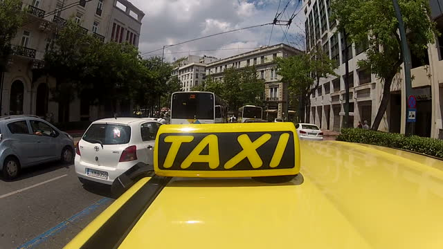shows exterior shots pov yellow taxi driving through the streets of athens on june 28 2015 in athens greece - panathinaiko stadium stock videos & royalty-free footage
