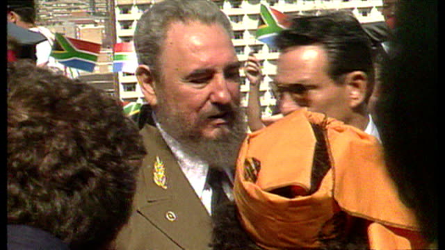 shows exterior shots president of cuba fidel castro arrives for nelson mandela's presidential inauguration ceremony in south africa on 2nd may 1994... - inauguration into office stock videos & royalty-free footage