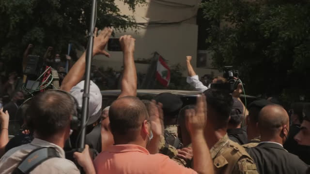 shows exterior shots president of france emmanuel macron being mobbed by large crowd as he tours streets of beirut in aftermath of deadly explosion... - lebanon country stock videos & royalty-free footage