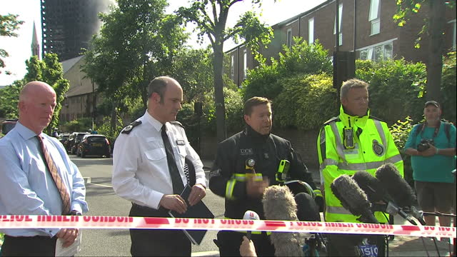 shows exterior shots press conference london fire brigade spokesman steve apter speaking on fire crews have made it to the top floor of grenfell... - brigade stock videos & royalty-free footage