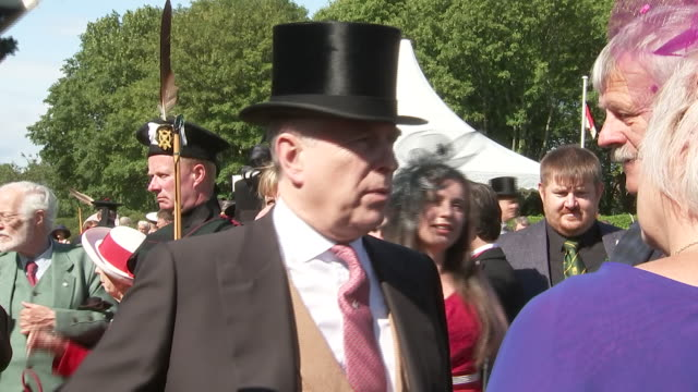 shows exterior shots prince andrew duke of york talking to guests at a garden party at the palace of holyroodhouse on 3rd july 2019 in edinburgh... - palace stock-videos und b-roll-filmmaterial