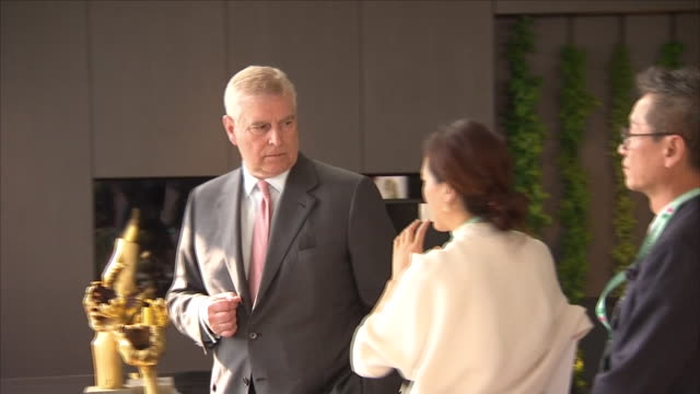 shows exterior shots prince andrew duke of york talking to woman at the chelsea flower show on 21st may 2018 in london england united kingdom - ヨーク公 アンドルー王子点の映像素材/bロール