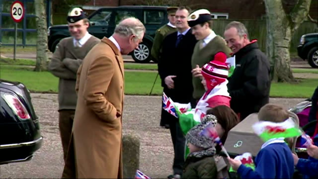 shows exterior shots prince charles, prince of wales, arriving in car, being greeted by captain rob mansel and talking to waiting parents and... - イーストアングリア点の映像素材/bロール