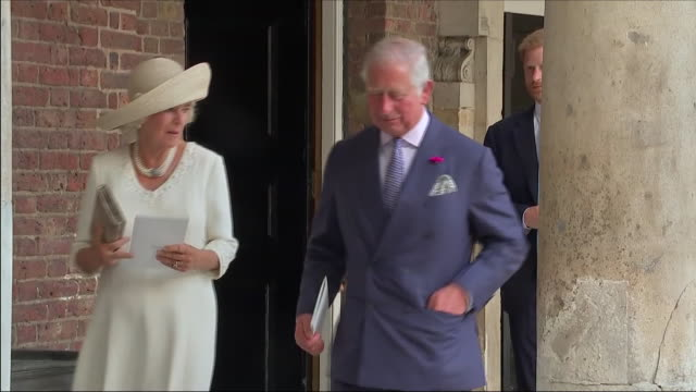 shows exterior shots prince charles prince of wales camilla duchess of cornwall prince harry duke of sussex and meghan duchess of sussex chatting as... - palace stock-videos und b-roll-filmmaterial