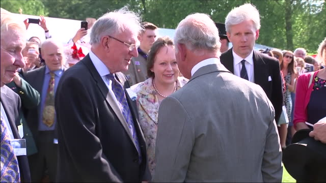 Shows exterior shots Prince Charles Prince of Wales talking to guests at an official Buckingham Palace Summer Garden Party to celebrate Prince...
