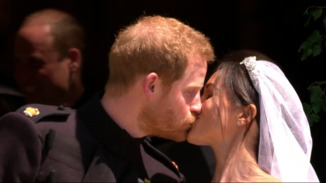 shows exterior shots prince harry and meghan markle walking out of st george's chapel sharing first kiss outside church before walking down steps on... - prince harry stock videos & royalty-free footage
