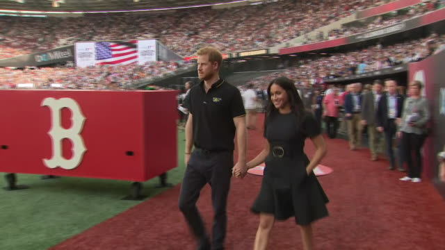 shows exterior shots prince harry duke of sussex and meghan duchess of sussex walking out onto the pitch with representatives from the invictus games... - meghan duchess of sussex stock videos and b-roll footage