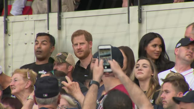 shows exterior shots prince harry duke of sussex and meghan duchess of sussex arriving at their seats in the stadium and starting to watch the game... - meghan duchess of sussex stock videos and b-roll footage