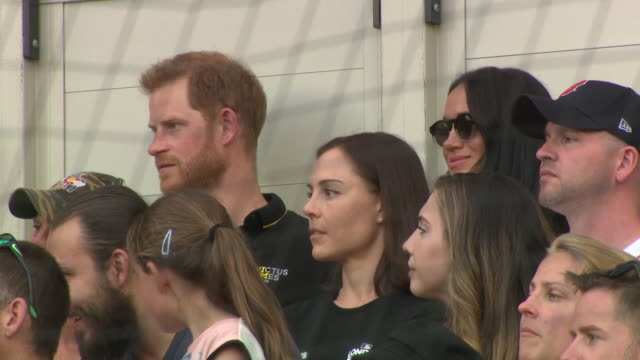 shows exterior shots prince harry duke of sussex and meghan duchess of sussex watching the game and leaving their seats in the stadium the duke and... - meghan duchess of sussex stock videos and b-roll footage
