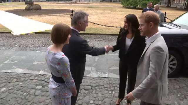 Shows exterior shots Prince Harry Duke of Sussex and Meghan Duchess of Sussex visiting Trinity College Dublin to see the Book of Kells The Duke and...