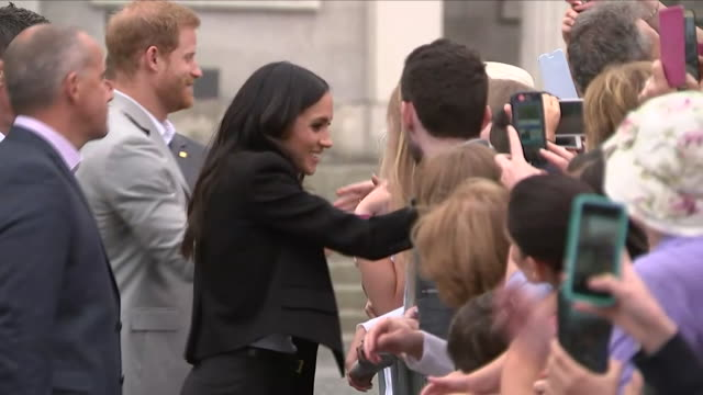 Shows exterior shots Prince Harry Duke of Sussex and Meghan Duchess of Sussex meeting the public on a walkabout following a visit to Trinity College...