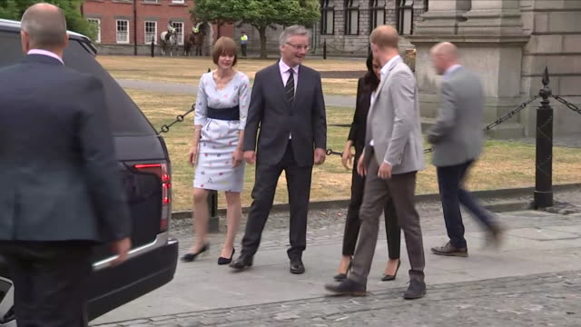 Shows exterior shots Prince Harry Duke of Sussex and Meghan Duchess of Sussex departing following a visit to Trinity College Dublin The Duke and...