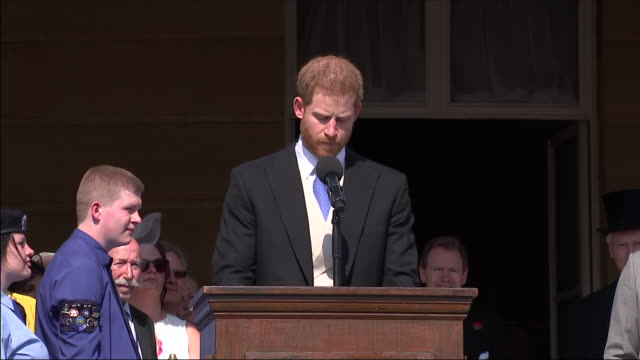Shows exterior shots Prince Harry Duke of Sussex giving speech on Prince Charles' involvement in various charities at an official Buckingham Palace...