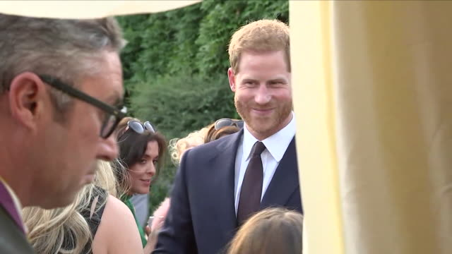 shows exterior shots prince harry, duke of sussex talking to guests at a reception at glencairn, the residence of robin barnett, the british... - robin day stock videos & royalty-free footage