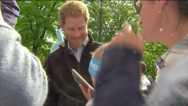 Shows exterior shots Prince Harry talking to Heads Together supporters and taking photos with a family during the London Marathon A record number of...