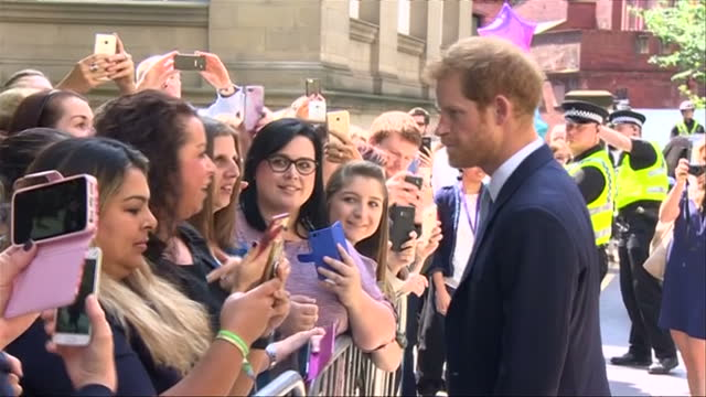 shows exterior shots prince harry walking down line of waiting members of the public shaking hands and chatting to people after attending the leeds... - mental wellbeing stock videos & royalty-free footage