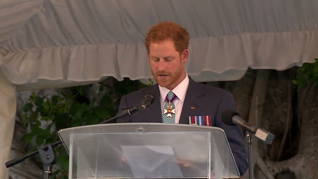 Shows exterior shots Prince Harry walking to stage giving speech on Barbados' Independence and walking away from stage Prince Harry has met...