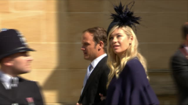 shows exterior shots prince harry's former girlfriend chelsy davy arriving at st george's chapel for the wedding of prince harry, duke of sussex, and... - girlfriend stock videos & royalty-free footage