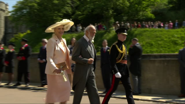 shows exterior shots prince michael of kent and princess michael of kent arriving at st george's chapel for the wedding of prince harry duke of... - princess michael of kent stock videos and b-roll footage