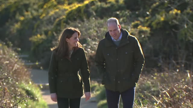 shows exterior shots prince william, duke of cambridge, and catherine , duchess of cambridge visiting howth cliff and taking a walk with views over... - ウィリアム王子点の映像素材/bロール