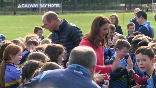 shows exterior shots prince william, duke of cambridge, and catherine , duchess of cambridge, talking to children before leaving the salthill gaelic... - western european culture stock videos & royalty-free footage