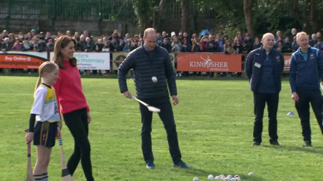 shows exterior shots prince william, duke of cambridge, and catherine , duchess of cambridge, having a go at hurling on competing teams as they play... - western european culture stock videos & royalty-free footage